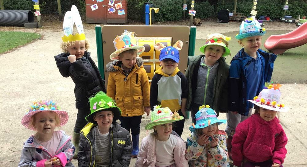A group of children posing with their Easter bonnets on