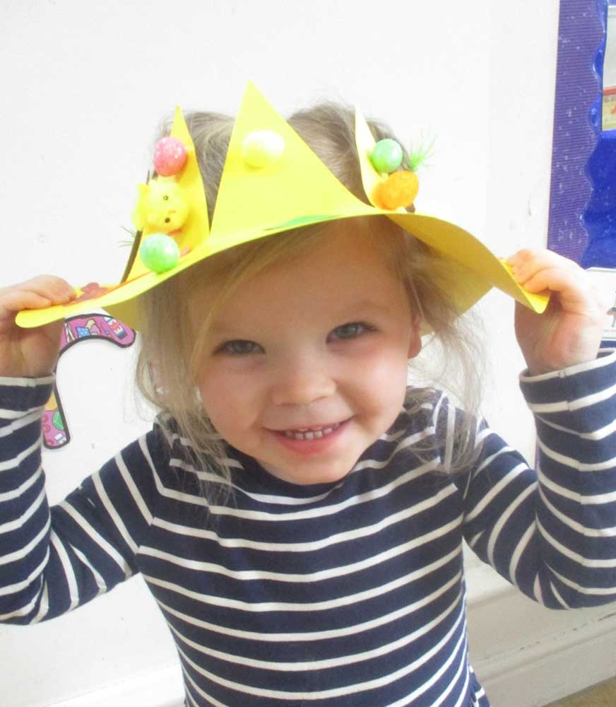 A young child wearing her Easter bonnet