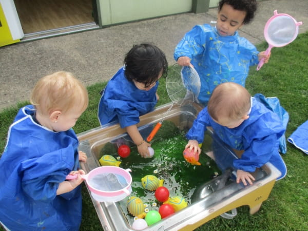Northwick Park Nursery and Preschool enjoy water play in the sunshine