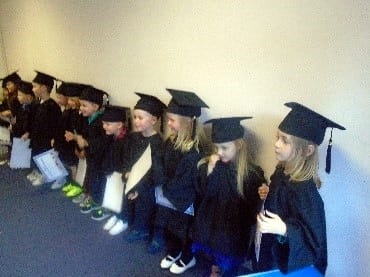 Preschool children attend a graduation ceremony as they prepare to leave for school at First Class Nursery and Preschool