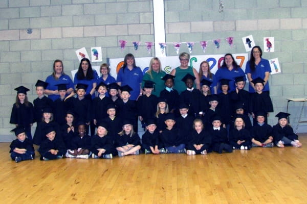 Preschool children at Treehouse Day Nursery and Preschool attend a graduation ceremony as the prepare to leave for school